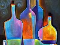 Het schilderen van kleurrijke glazen flessen