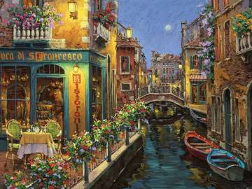 canal with boats in the city