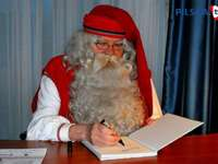 Santa Claus from Lapland writing a letter - m ...................