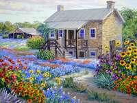 Pintura casa con campos de flores.