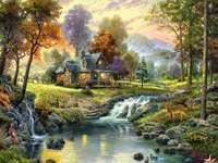 trähus vid floden med ett vattenfall - m ...................