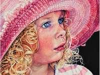 dívenka s modrým kukadlem a kloboukem