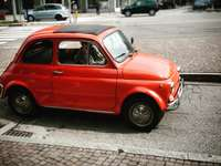 red volkswagen beetle parked on sidewalk during daytime - Como, Province of Como, Italy
