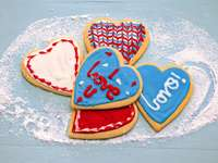 red and white heart shaped cake - red and white heart shaped cake on white and blue floral textile. Sugar cookies to spread the love .