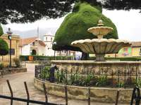Town of Tópaga - in this puzzle the church, the characteristic pine trees of the park and the fountain are in plain s