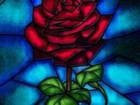 Rosarium - röd ros på en blå bakgrund