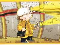 Nella miniera - L'immagine mostra un ragazzo con una torcia.