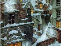 Met sneeuw bedekte daken in de stad