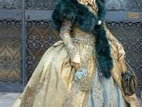 Venezianische Masken und Kostüme