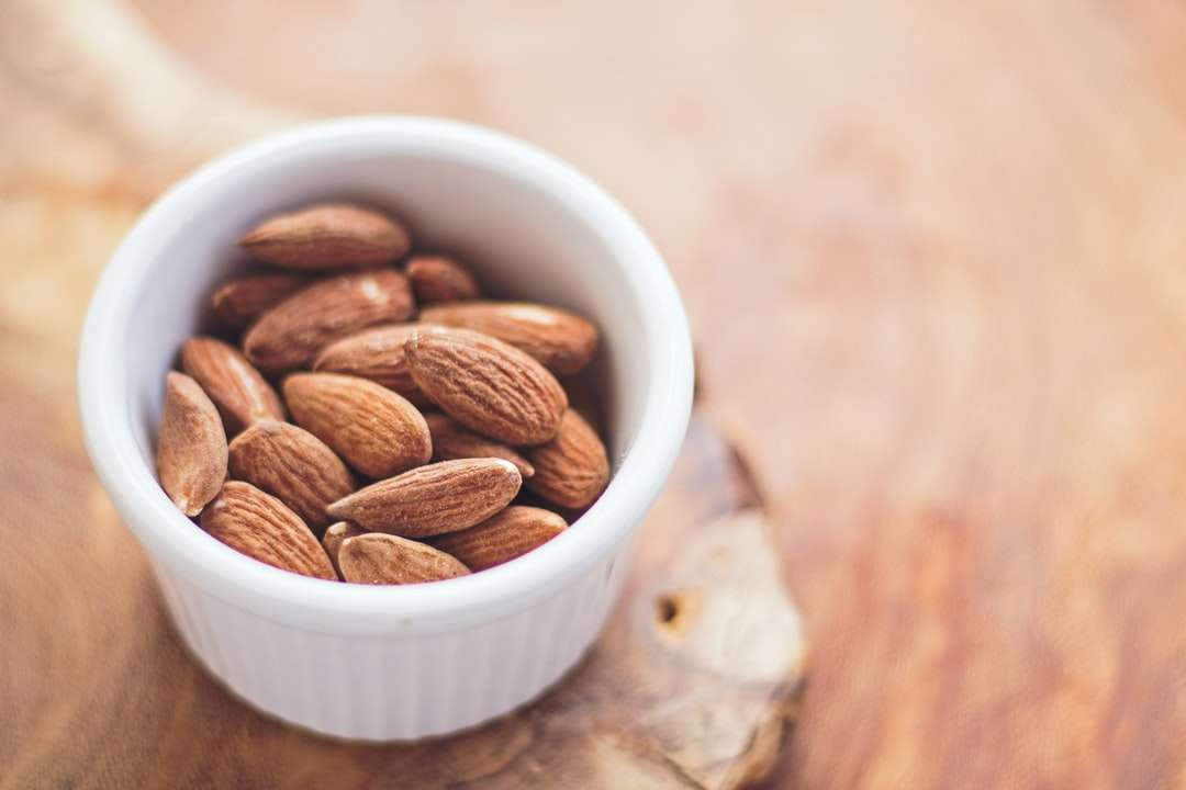 shallow focus photography of almonds in white ceramic bowl - Healthy Almond Snack (3×2)
