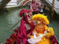 Maskers en kostuums van carnaval in Venetië