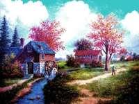 Moulin de peinture et fermes à la campagne au bord du ruisseau