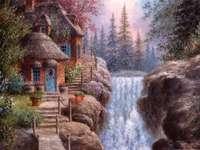 Casa de pintura junto a la cascada
