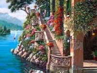 Målarhus vid sjön och båten