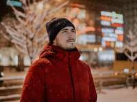 man in red jacket and black knit cap