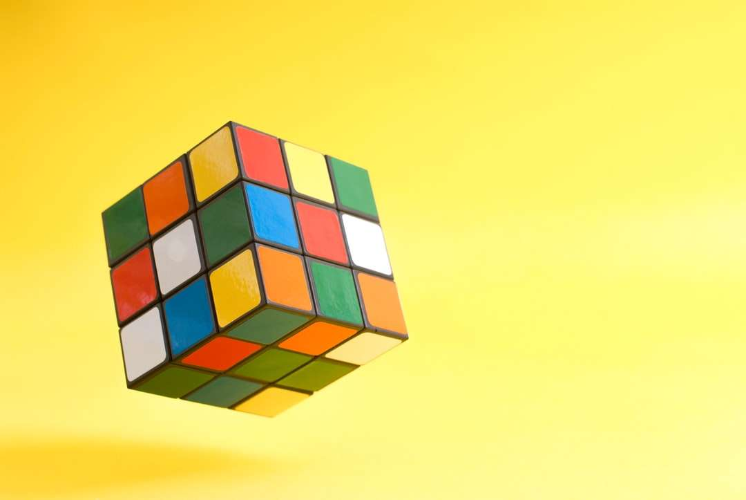 3 x 3 rubiks cube - Flying Rubik's cube on yellow background (8×6)