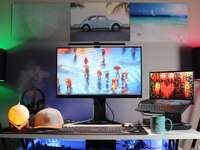 Monitor de computadora de pantalla plana negra en el escritorio blanco