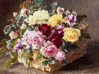 Panier de peinture avec des roses