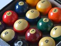 billiard balls on blue surface