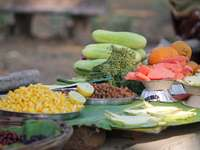 green and yellow corn on brown wooden table