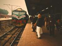 people standing beside train station during daytime