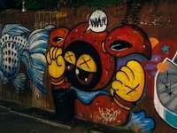 żółty i czarny kot graffiti