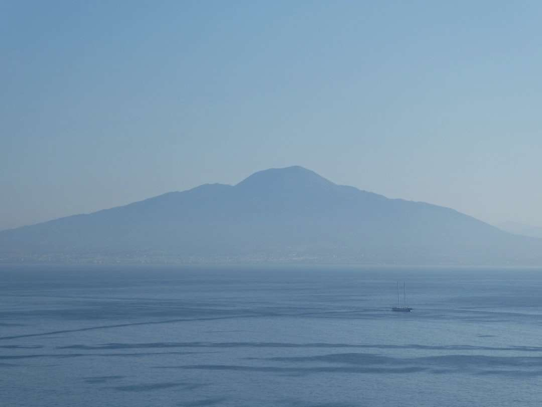 boat on sea during daytime - Looking across the Bay of Naples just before the sun rise   Mount Vesuvius is shrouded in the early morning mist.  . Sorrento, Metropolitan City of Naples, Italy (17×13)