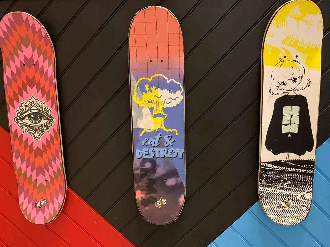 white and red mickey mouse print skateboard deck - Looking in a shop window  I marvelled at the artwork on the three skateboards. . Southampton, UK (5×4)