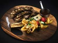 cooked food on brown wooden round plate