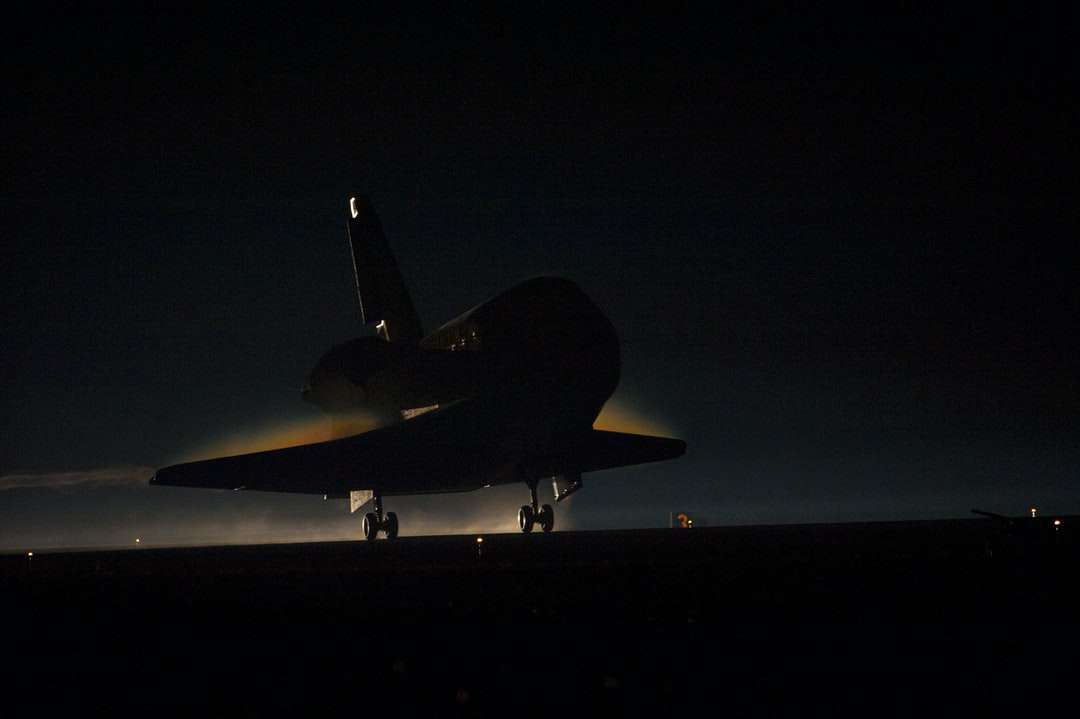 Space Shuttle Atlantis lands in the dark - Ribbons of steam and smoke trail space shuttle Atlantis as it touches down on the Shuttle Landing Facility's Runway 15 at NASA's Kennedy Space Center in Florida for the final time. Kennedy Space Cente (7×5)