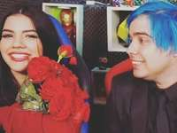 Yolo gives roses to Mariana in a video
