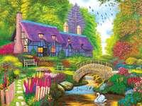 Haus mit lila Dach