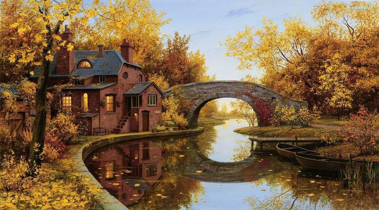Ház a folyóhoz egy híddal ősszel