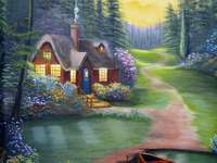 Een huis in het bos bij de rivier