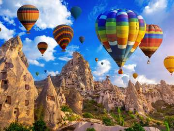 Balloons over a stone city