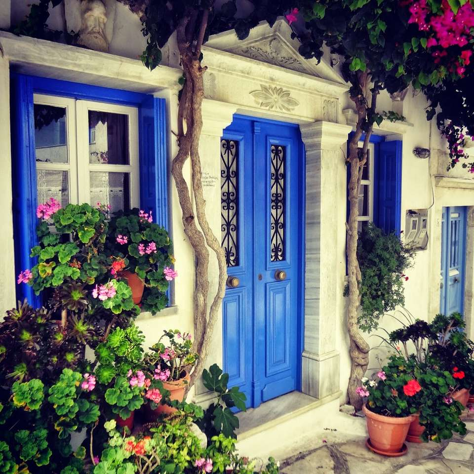 A house with shutters on the island of Tinos