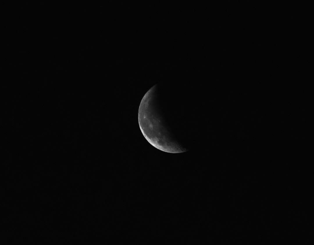 grayscale photo of moon in dark night sky