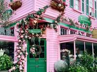 A pink house in flowers