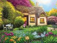 Casa rural en el campo con un jardín de flores.