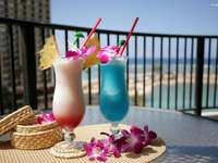 Cocktails on the balcony overlooking the sea