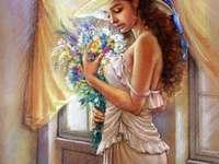 Hübsches romantisches Mädchen am Blumenstrauß von Blumen