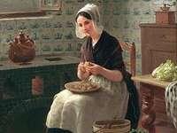 Młoda kobieta przygotowuje posiłek
