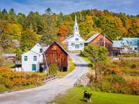 Waits River Village, Vermont, USA with autumn foliage.