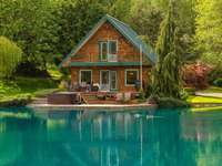 A house in the forest over the water