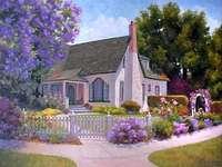 Graziosa casa, circondata da fiori.
